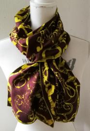 Exclusief batik sjaaltje uit Oost-Java. Choco/geel. 30x195 cm. 100% rayon. Wasbaar op 30 graden.