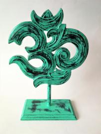 Schitterend handwerk dit Ohmteken uit het Boeddisme en Hindoeisme. 25 x 20 cm. Groen gelakt.