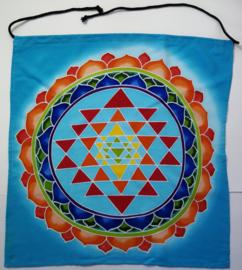 Meditatie doek 'Vishuddha'. Mantra 'Ham'. Batik uit Ubud, 50x 50 cm. Met ophangkoord. 50x 50 cm