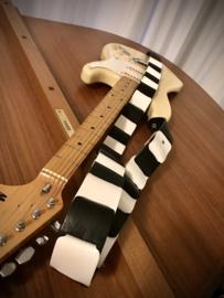 Liam's gevlochten gitaarband