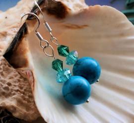 Paar C&G Oorbellen: echt Turquoise Howliet en facet glas