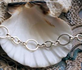 Cirkels 6+10 mm: Basis voor armband/ketting - per 20 cm - Zilver Kleur