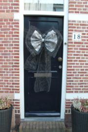 Zwarte deurstrik met zilver
