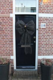 Zwarte 'spinrag' deurstrik met goud 'hart'