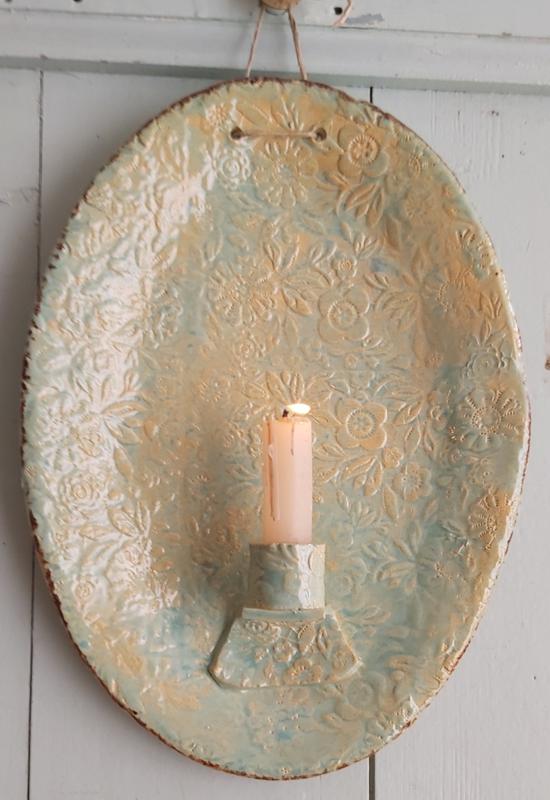 Kaarsenbord met bloemmotief