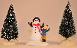 Kindje met sneeuwpop