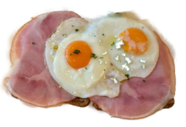 2 gebakken eieren en 2 boterhammen ham met thee, koffie of sinaasappelsap.