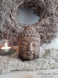 Stenen buddha hoofdje