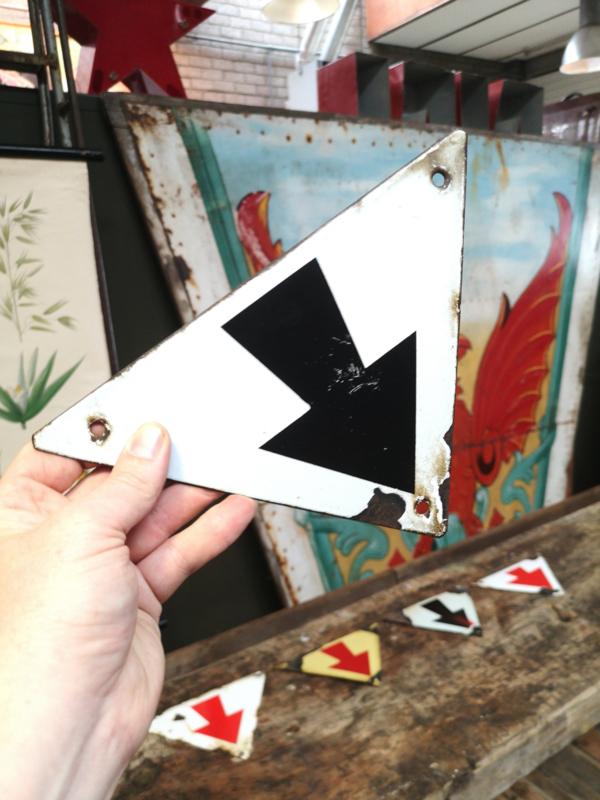 Old triangular enameled arrow sign