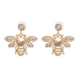 Oorbellen bijen goudkleur met strass