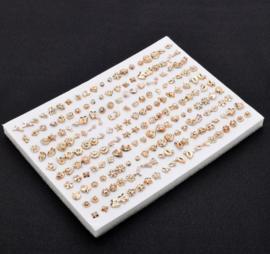 100 paar verschillende oorbellen goudkleur (zonder dopjes)