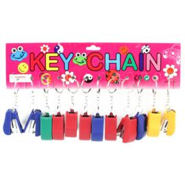 12 stuks sleutelhanger met mini nietmachine - uitdeelcadeautjes
