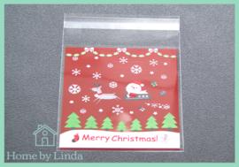 Cellofaan zakjes kerst - kerstman en slee 10 cm x 10 cm (set van 10 stuks)