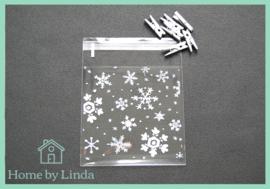 Cellofaan zakjes kerst - sneeuwvlokken 10 cm x 10 cm (set van 10 stuks)