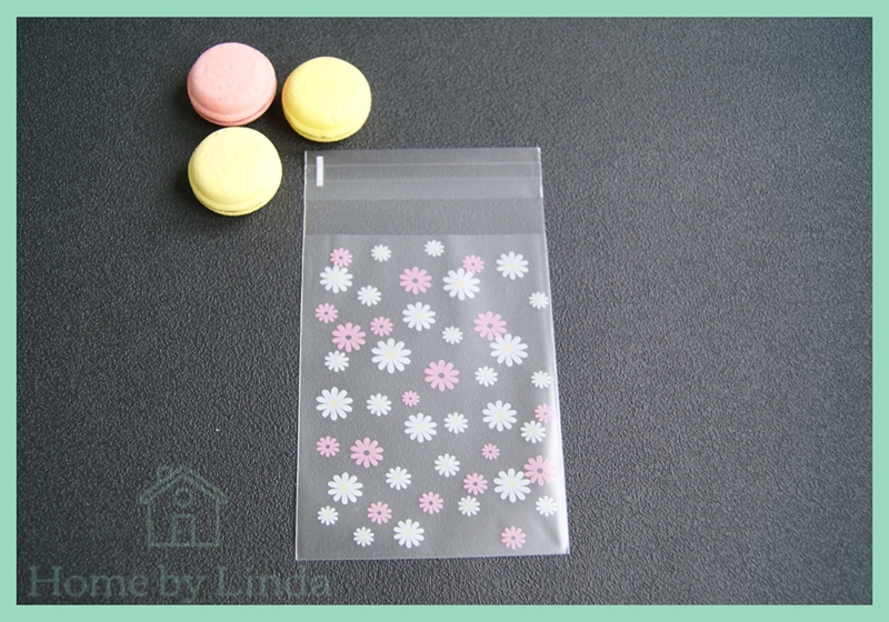Cellofaan zakjes wit roze bloem 8 cm x 10 cm (set van 10 stuks)