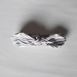 Knoophaarband 6mnd-2jaar Zebra Grijs