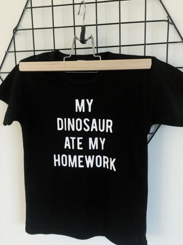 Shirt 'My dinosaur ate my homework'.