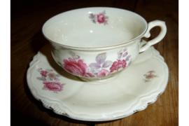 Antiek kop en schotel met roze bloemen