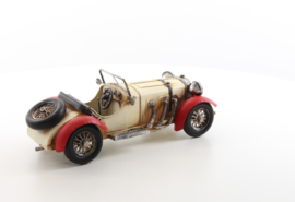 A TIN MODEL OF AN OLDTIMER white