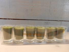 6 kaarsjes in glaasje in kleur groen 8 branduren p. Stuk