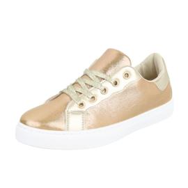Prachtige goudkleurige sneakers