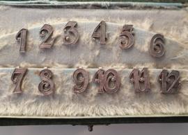 Set antieke zilveren tafelnummers