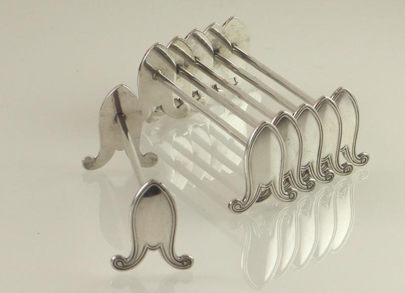 Set van zes zilveren messenleggers, 1931