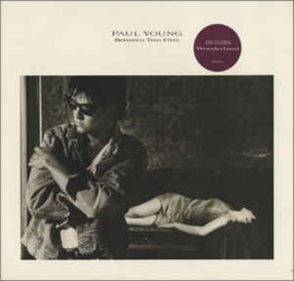 Paul Young ‎– Between Two Fires