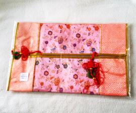 Tissuehoes zalmroze met bloemen - D12524