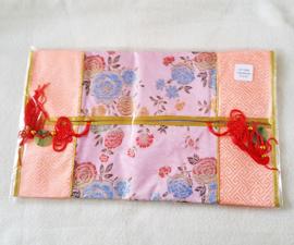 Tissuehoes zalmroze met bloemen - D12526