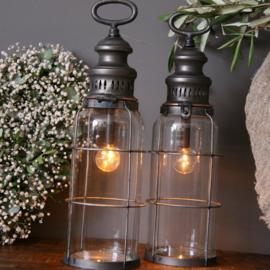 Windlichten, kandelaars, lantaarns en kaarsen
