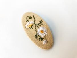 Speldje stof bloem