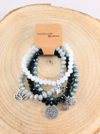 Setje vrolijke armbandjes - zwart, grijs en wit