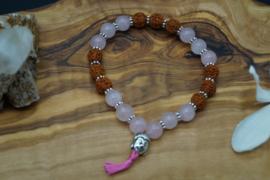 Bracelet with rose quartz and rudraksha beads