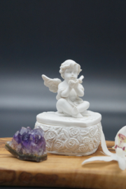 little box with angel on top