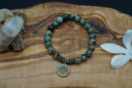 Bracelet with African turquoise beads and lotus charm
