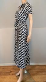 Doorknoop jurk travel print zwart/off-white