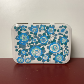 Vintage blauw bloemenblik