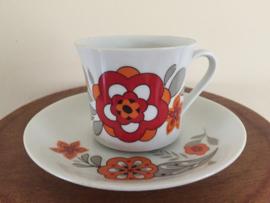 Vintage kop en schotel rode bloem