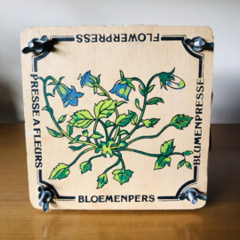 Vintage bloemenpers