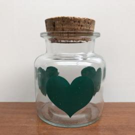 Vintage voorraadpot met groene hartjes