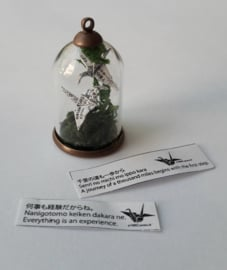 Little biodome with origami cranes with Japanese wisdom or personal name on their wings
