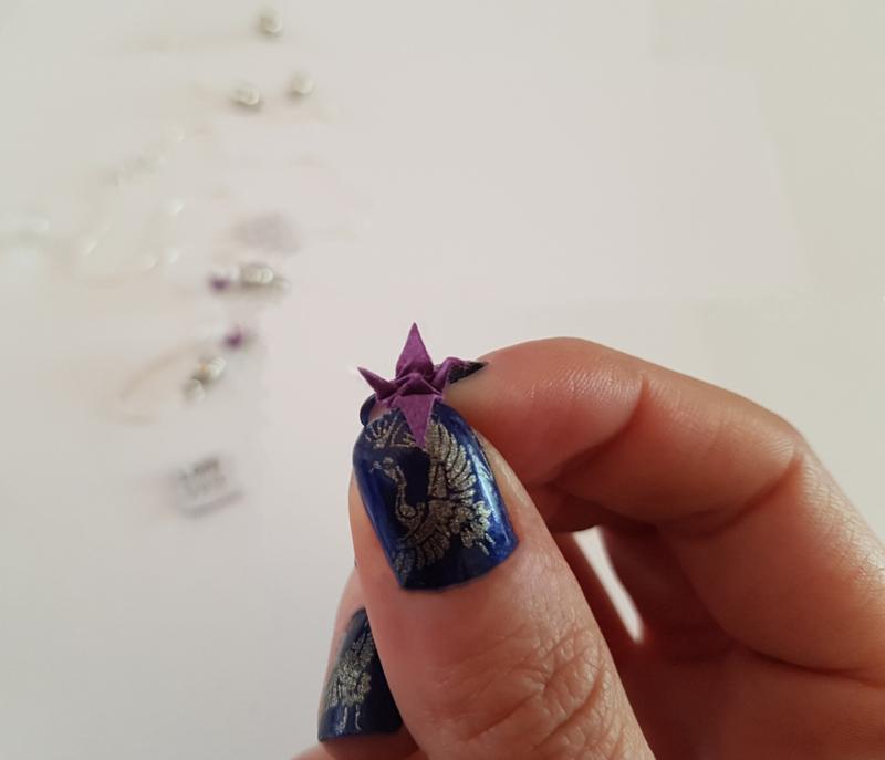 Ketting met handgevouwen mini-kraanvogel in bulb