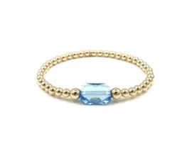 Armband Shiny met licht blauw Swarovski crystal en real gold plated balletjes