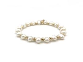 Armband Nena met gouden balletjes en ovale zoetwaterparels