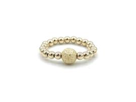 Elastische ring Chelsey met gouden balletjes en stardust bal