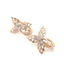 Occasion bicolor bladvormige oorbellen met diamant 0.09ct