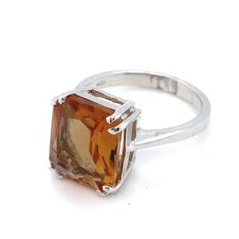Occasion zilveren ring bezet met een goud- oranjekleurige zirkonia