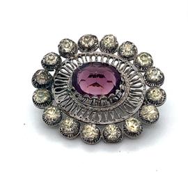 Occasion ovale zilveren broche met een paarse steen