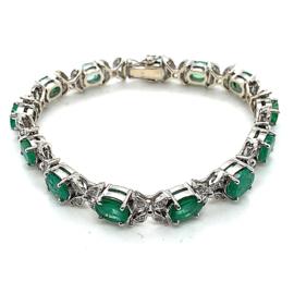Occasion witgouden armband met smaragd en 0.78ct diamant